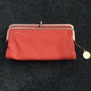 NWOT Big Buddha orange clutch wallet